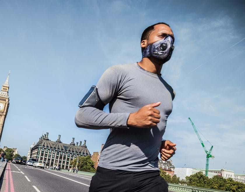 Man running across Westminster Bridge with mask on