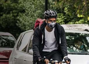 Man cycling in road