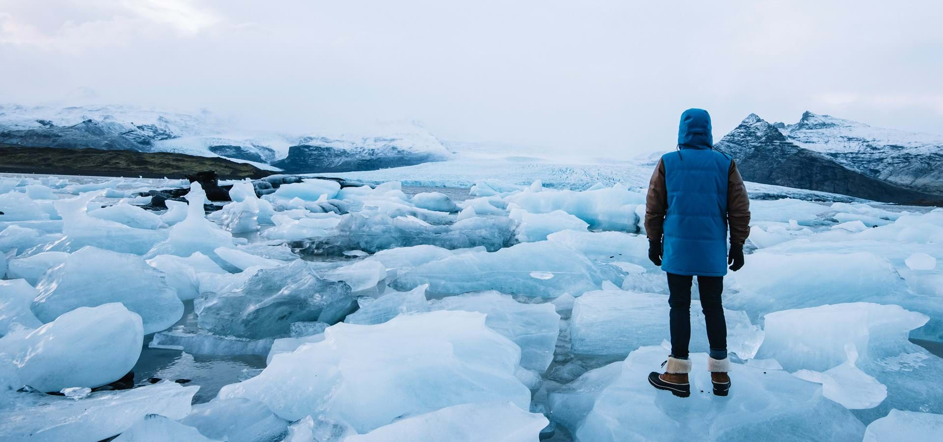 Man standing in front of icy sea